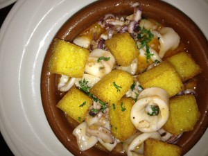 Squid with lemon wine sauce and polenta